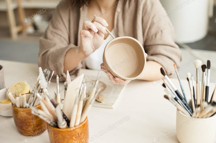 A young woman at pottery class,  creative, hobby, hands in frame, being creative, handmade, artisana