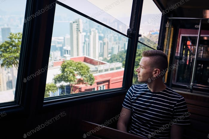Tourist traveling by tram in Hong Kong