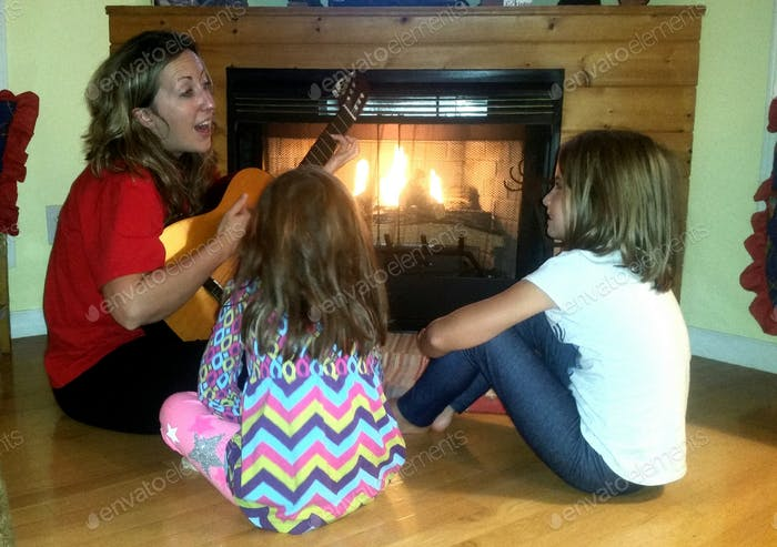 "Mother singing ""I lite the fire"" to her kids..."