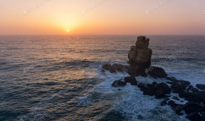 Enoying a sunset from a cliff