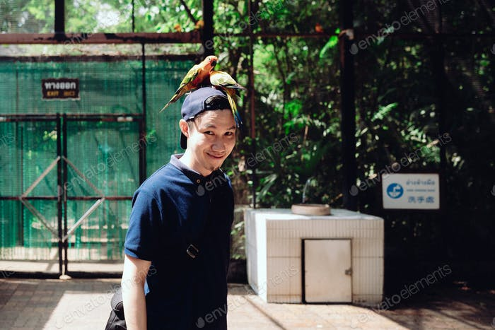 Happy man with birds on his head