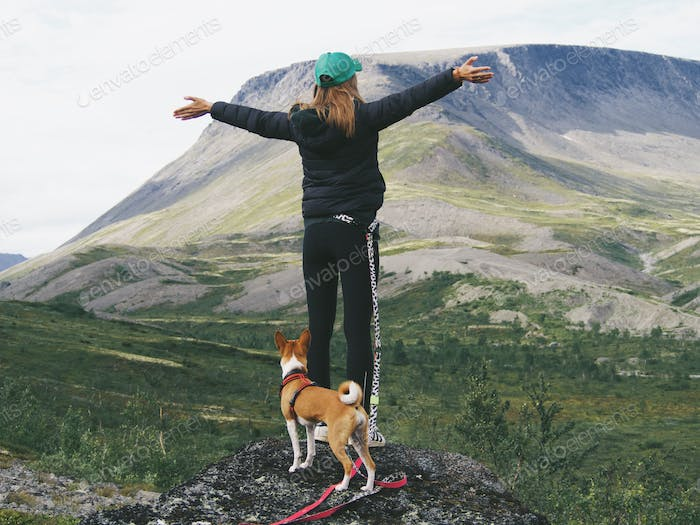 woman with her dog in the mountains, freedom