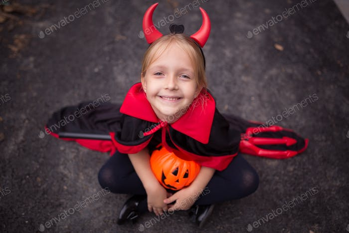 Happy kid in evil costume for Halloween 2020 during coronavirus covid-19 pandemic