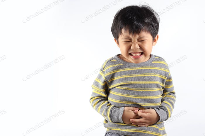 Asian boy having stomach ache, isolated on white background.