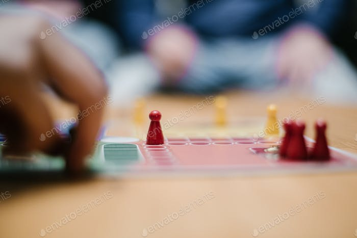 Playing board game with friends at home