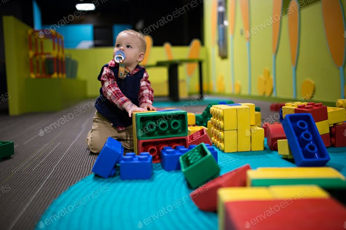 Toddler baby playing at a day care