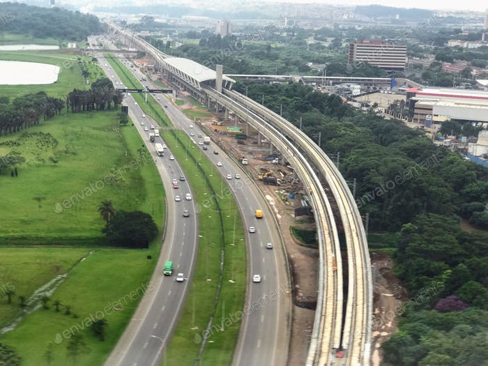 Top view of São Paulo Brazil busy road and train trucks