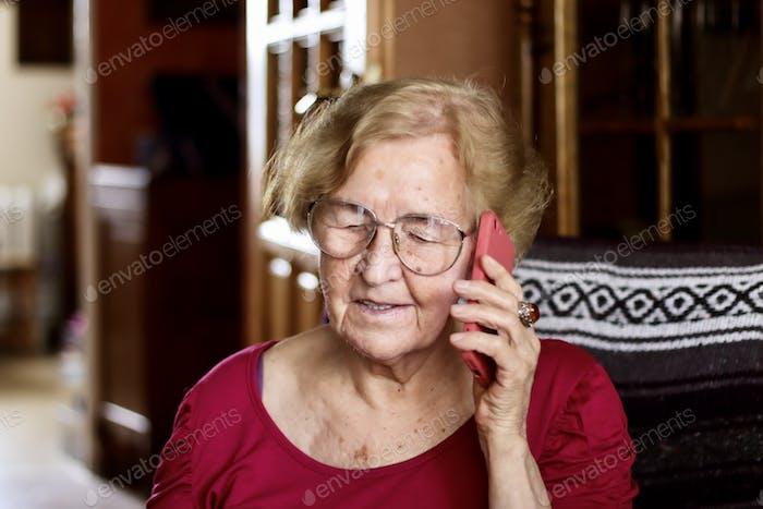 Grandma is talking on the phone.