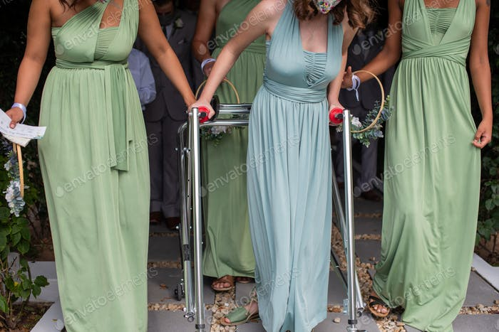 Young autistic woman using a stroller during wedding ceremony