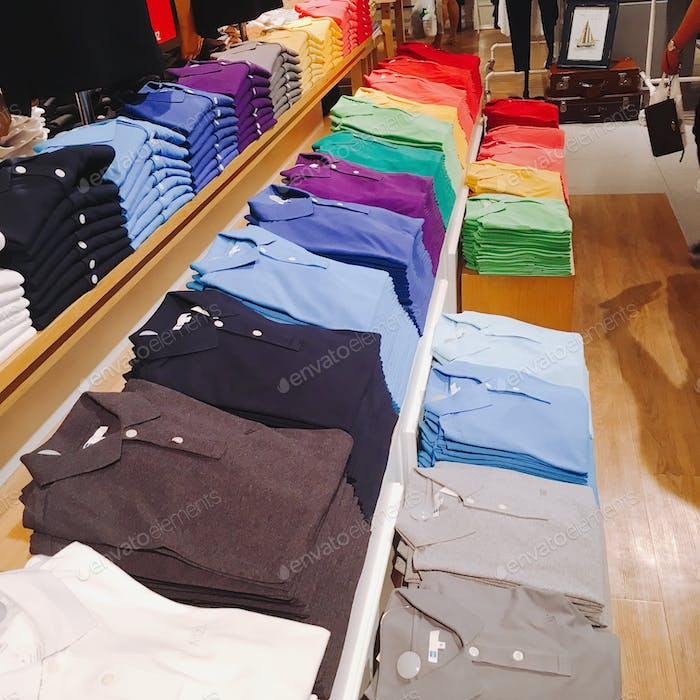 Rainbow colours t shirts display in a shopping centre