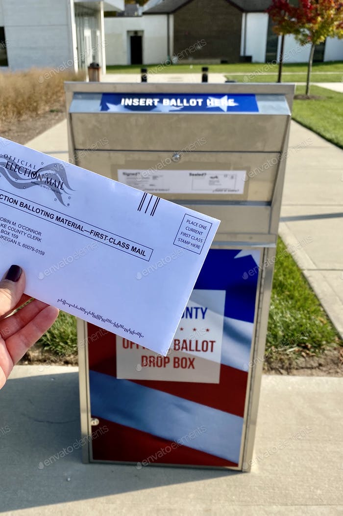 Dropping off mail in ballot at official ballot drop box
