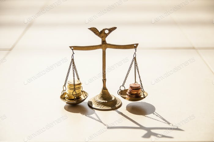 Coins on brass weight scales