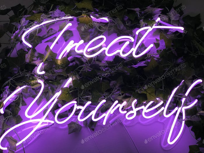 """Purple neon lights with the phrase """"Treat yourself"""""""