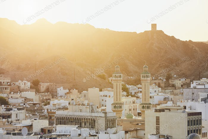 Cityscape view of Muscat city at sunset. The capital of Oman.
