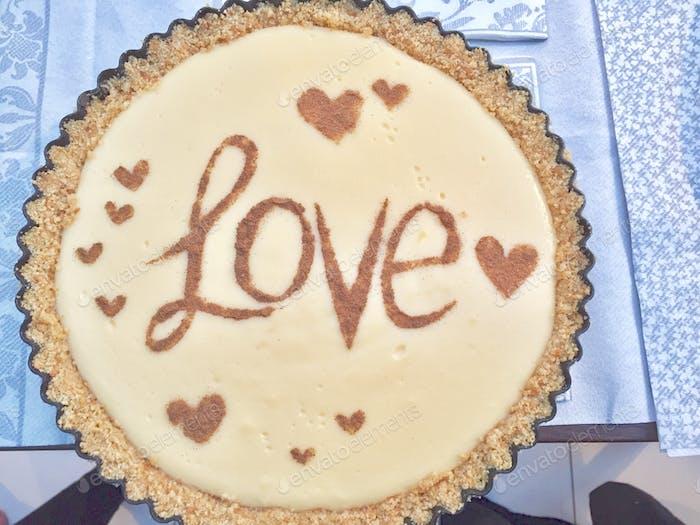 Word Love on dessert topping