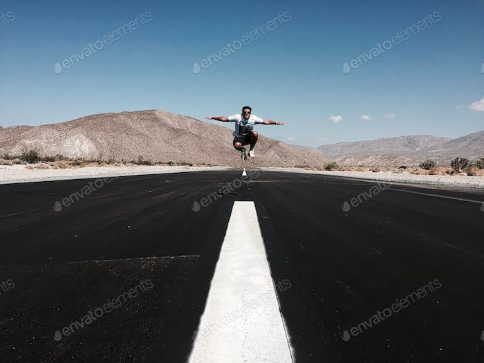 Plane taking off on a cool runway in the middle of the San Diego County desert.