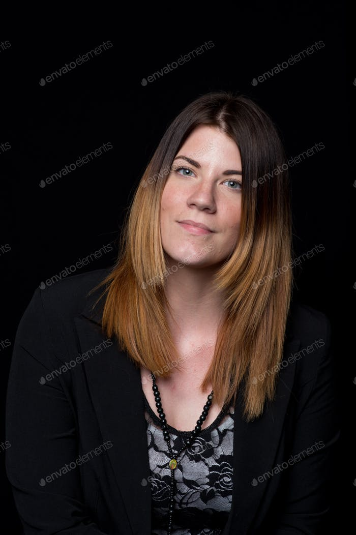 Portrait of a young woman with ombré hair wearing a blazer.