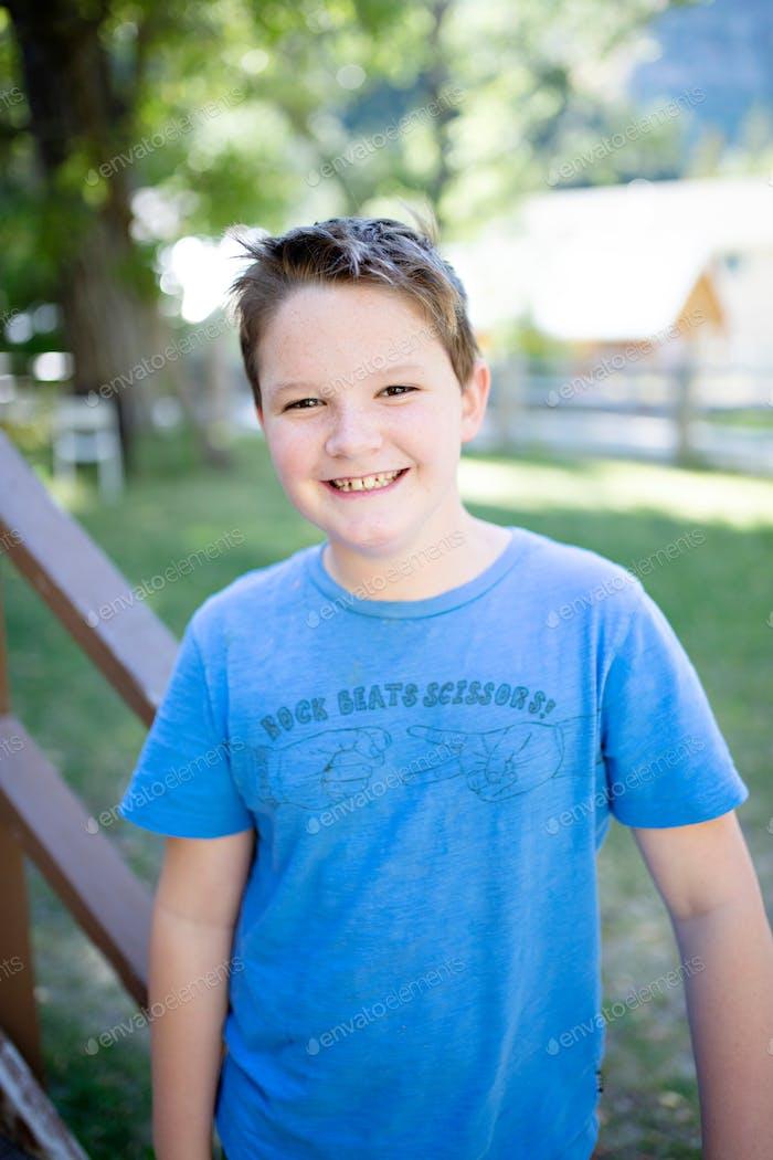 Happy tween boy smiling