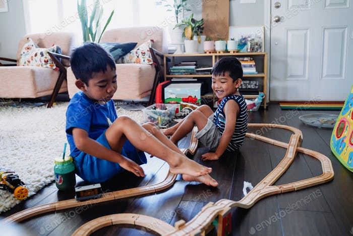 Diverse young little boy inside house home school vacation stay at home shelter in place during