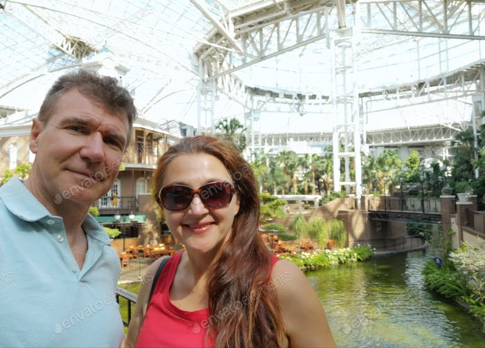 Mature couple is enjoying their stay in  famous Gaylord resort in Nashville, Tennessee