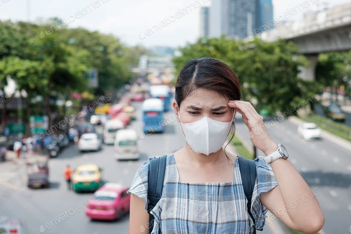 Asian woman wearing N95 respiratory mask protect and filter pm2.5 (particulate matter)