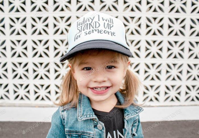 Toddler girl wearing hat
