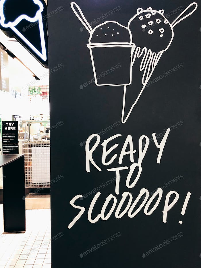 Ready to scoop. Ice cream. Ice cream shop. Words in the wild. Words on the wall.