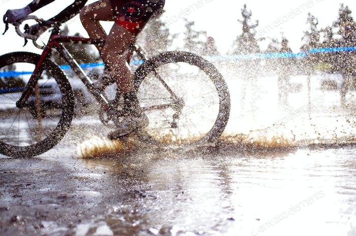 Cyclocross: bikes, water, mud, racing.