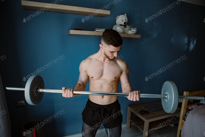 guy exercising with barbell at home