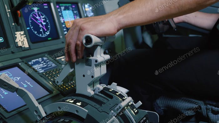 Pilot Holding Hand On The Thrust Lever Handle For Engine Control Of Airliner.