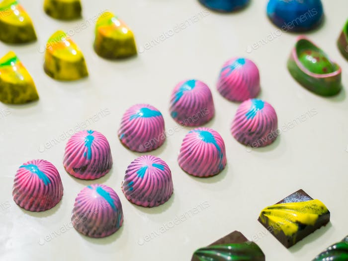Set of colorful luxury handmade bonbons on white background