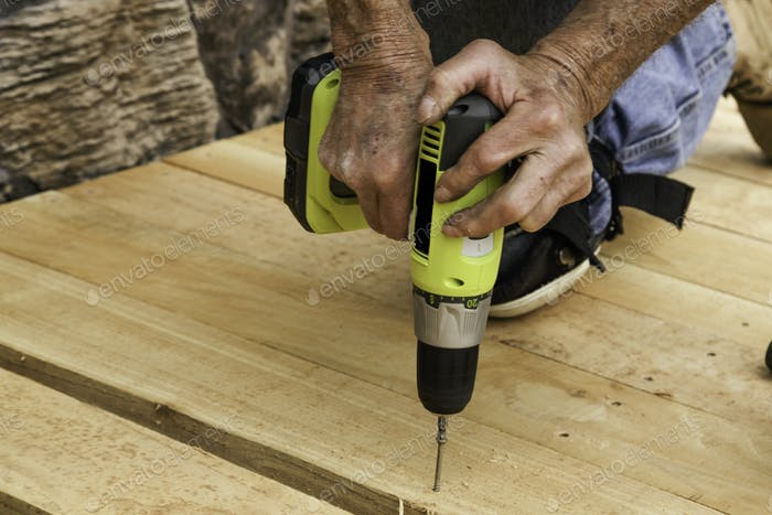 Pre-drilling the holes for the bolts.