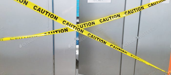 CAUTION! Do not enter this area! Public toilets, Out of Order! Beware! Caution!