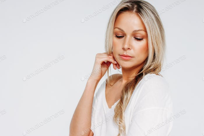 Beauty portrait of blonde smiling woman 35 year plus clean fresh face isolated on the white