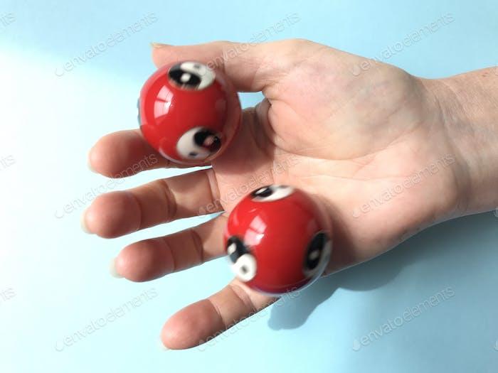 Stress Relief : Woman using Yin Yang or Tai Chi balls