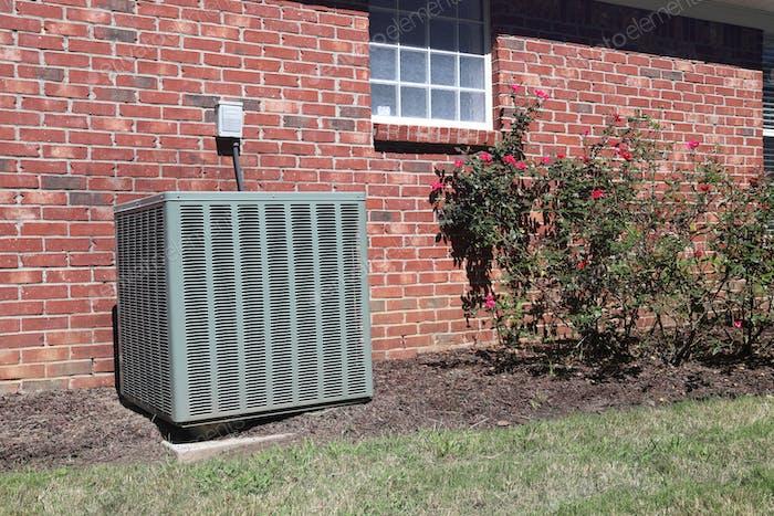 Air conditioner system near home, HVAC unit.