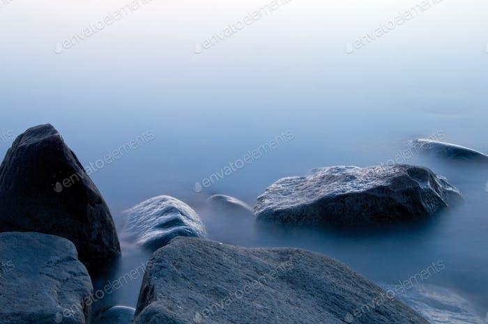 Rocks in water blue hour