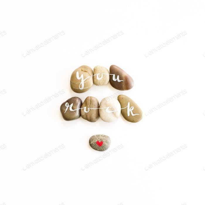 You rock! :) Stones of encouragement on a bright white background.
