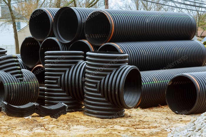 Stacked new PVC pipe for under construction of housing project