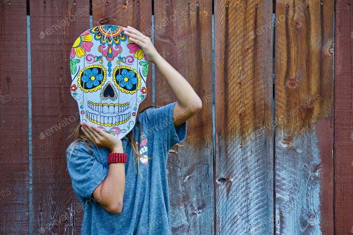 Niedliches Mädchen feiert Dia De Los Muertos, oder Dia Muertos, Tag der Toten, Día de Muertos, tonytheti