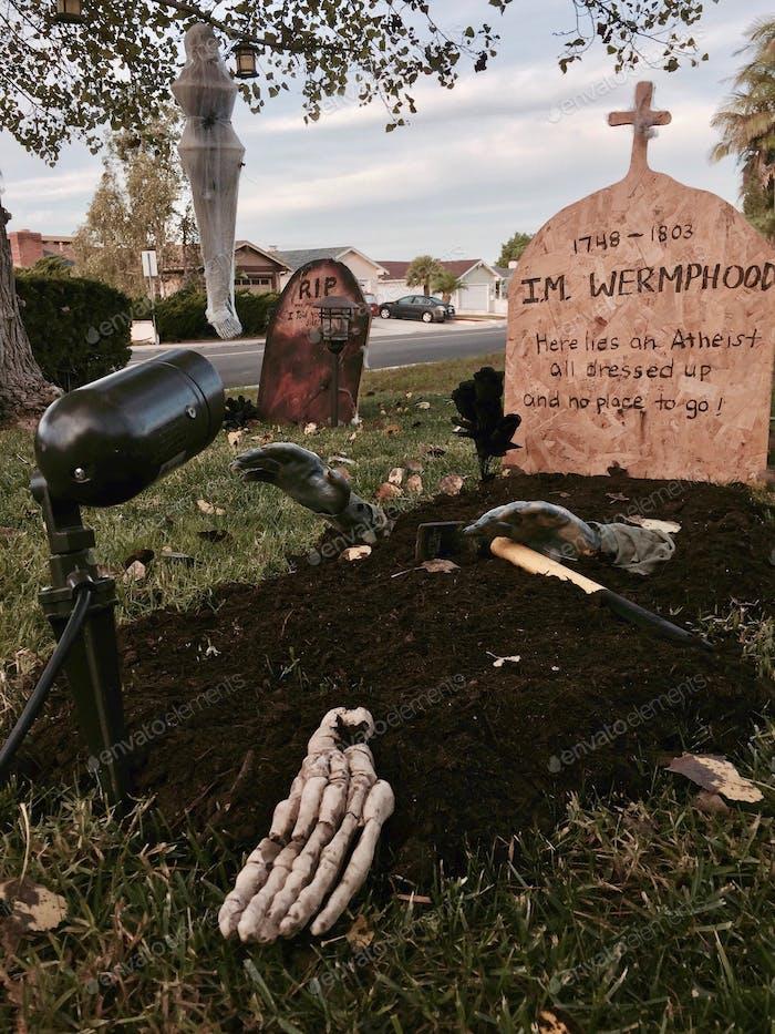 Halloween graveyard display in the front yard.