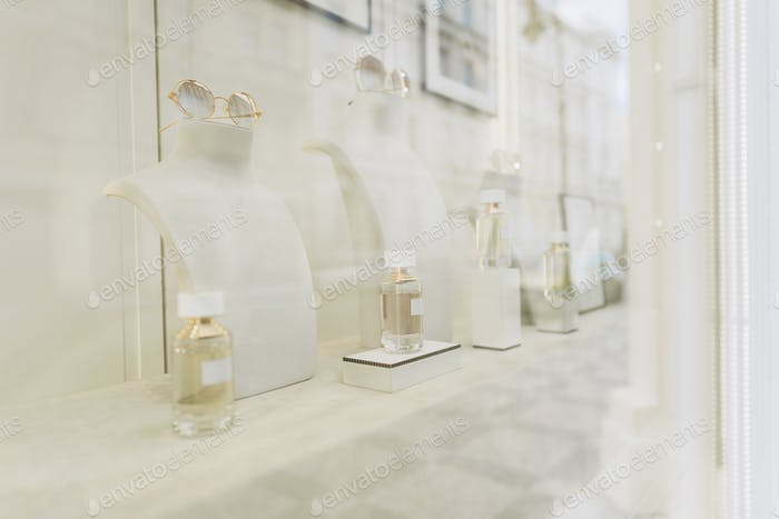 Glass bottles of women's perfume in the window of a luxury perfume store