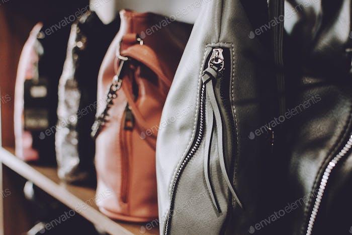 Fashion trend handbags on shelf in a store, shop