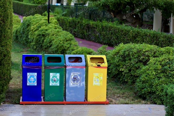 Different colored recycle garbage trash bins (cans) in the park