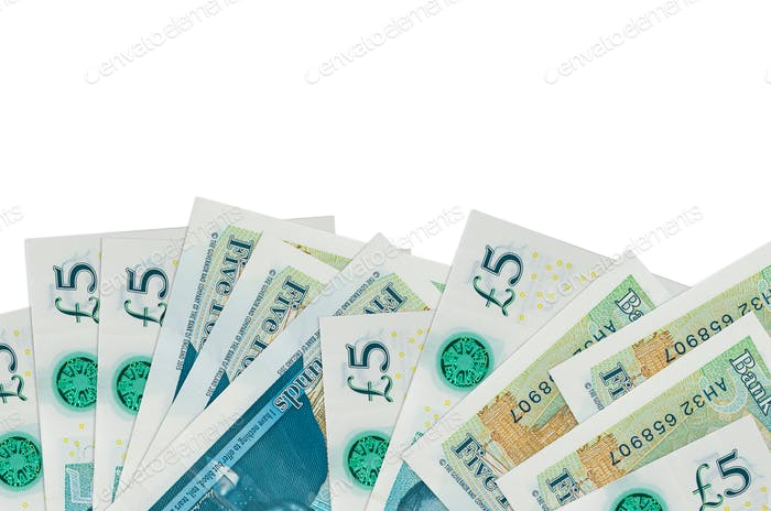 5 British pounds bills lies on bottom side of screen isolated on white background with copy space.