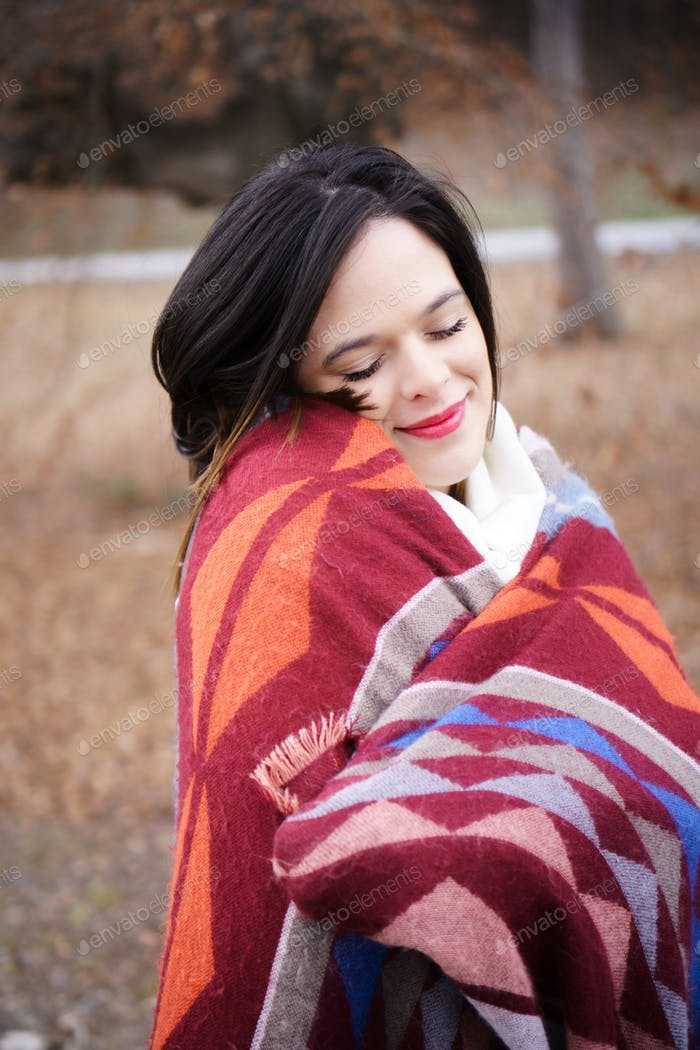 Woman in cozy snuggle weather wrapped in blanket