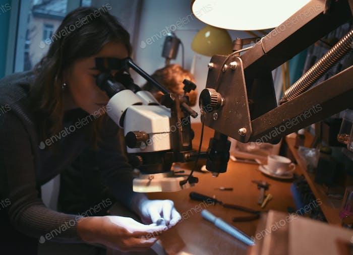 A woman jeweler at work
