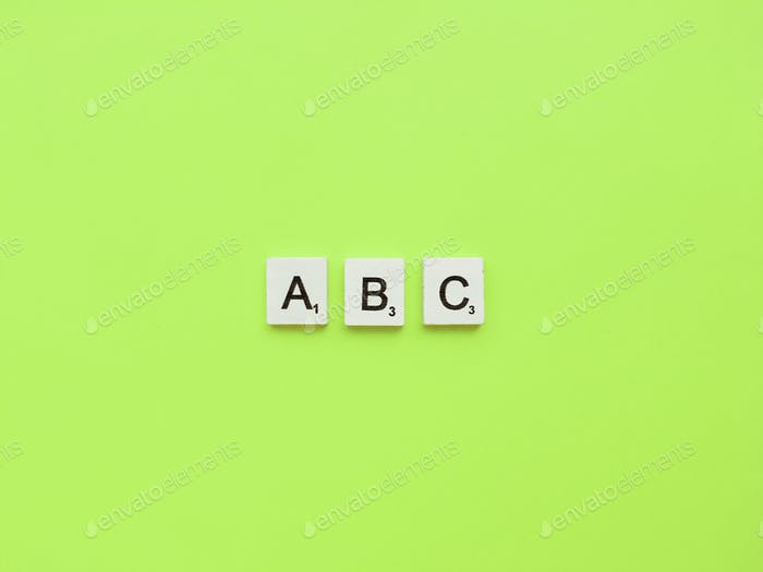 ABC scrabble letters word on a green background