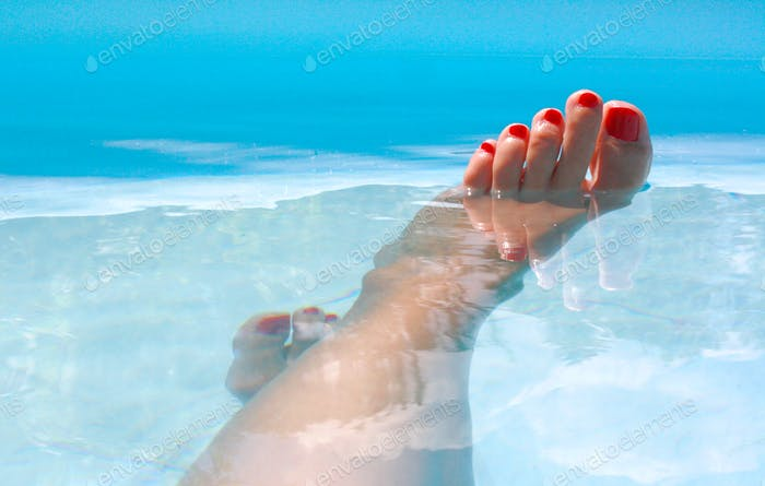 Relaxation, bare feet in the water