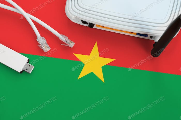 Burkina Faso flag depicted on table with internet rj45 cable, wireless usb wi-fi adapter and router